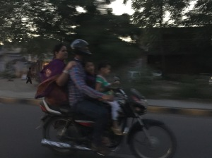 A family of 4 on a motorbike