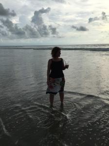 Catherine paddling on Benaulim Beach