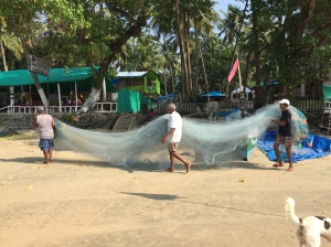 Men carrying fishing nets, Palolem, Goa