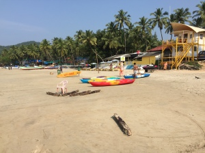 Kayaks and wooden boat sliders on Palolem beach, Goa, India