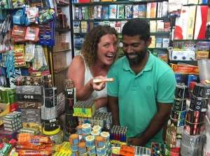 Catherine behind the till with Sanjay and a packet of Frutella, Palolem beach, Goa