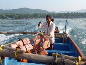 The crew checks the lifejackets on a dolphin watching trip