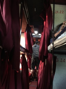 The central isle of a sleeper coach from Palolem to Hampi