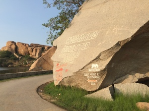 A fictitious rock sign warning of crocodiles in the Tungabhadra reservoir