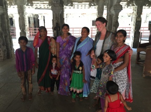 Catherine having her photo taken by a family in the Ranga Mandapa, Hampi