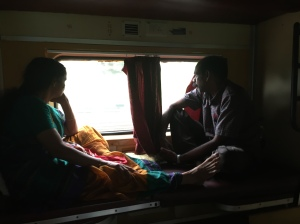 A couple looking out of the window of a train in Kerala